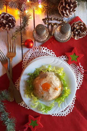 Aspic jellied meat with vegetables on Christmas background Stok Fotoğraf - 130611345