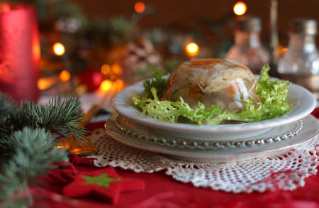 Aspic jellied meat with vegetables on Christmas background Stok Fotoğraf - 130611313