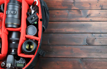 DSLR camera accessories on wooden background 写真素材