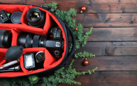 DSLR camera accessories on Christmas background