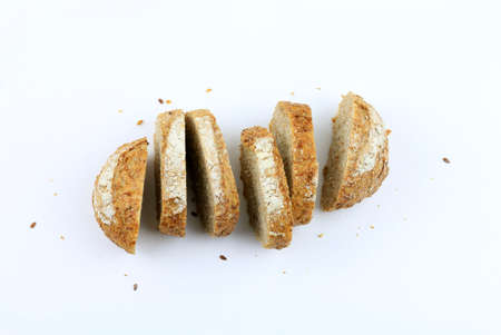 Slices of wholemeal bread with seeds on a white background Stok Fotoğraf