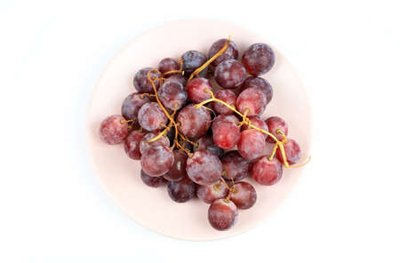 Red grapes isolated on a white background. View from above