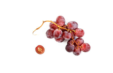 Ripe red grapes isolated on white background. View from above
