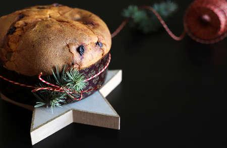Christmas holiday.Traditional Italian Christmas Panettone cake with dried fruits on dark background. Closeup. 版權商用圖片