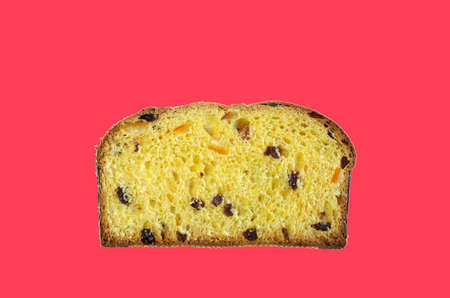 Christmas holiday. A slice of traditional Italian Christmas Panettone cake with dried fruits.