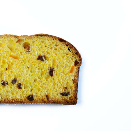 Traditional Italian Christmas Panettone cake with dried fruits on white background.