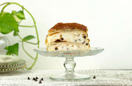 Millefeuille dessert with chocolate drops isolated on white background. French cuisine