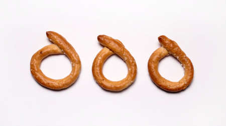 Salty pretzels isolated on white background. Directly above.