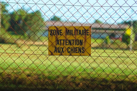 Sign of warning of military zone MILITARY AREA, BEWARE OF DOGS