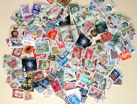 Hundreds of colorful international postage stamps Stock Photo