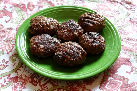 barbequing: Six charcoal grilled hamburgers Stock Photo
