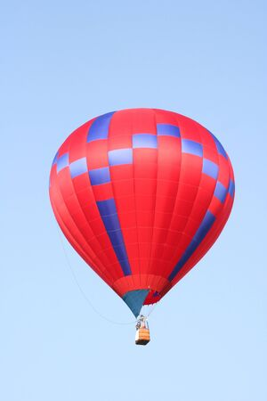 Red and blue hot air balloon flying photo