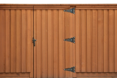 Closed gate in a wooden fence Stock Photo