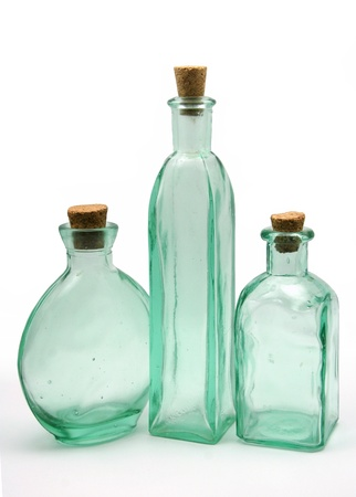 3 empty glass bottles photo