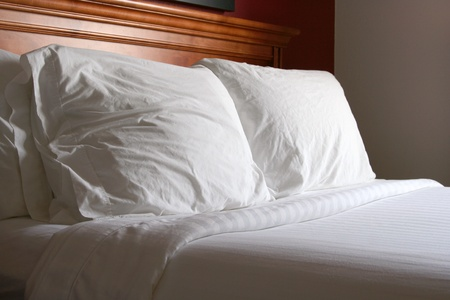 bedding: White bed and pillows