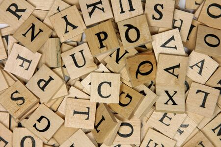 Wooden alphabet tiles Stock Photo