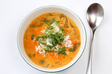 Spicy red curry Thai soup and rice photo