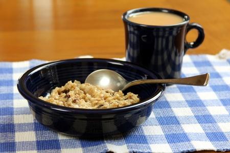 Oatmeal breakfast with tea cup photo
