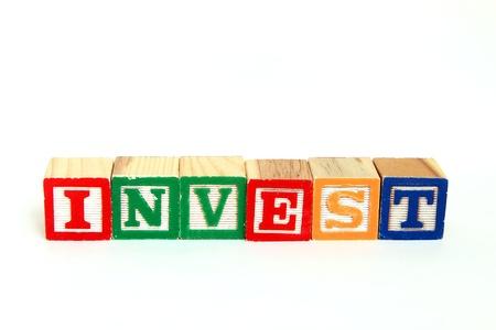 Invest in alphabet blocks Stok Fotoğraf