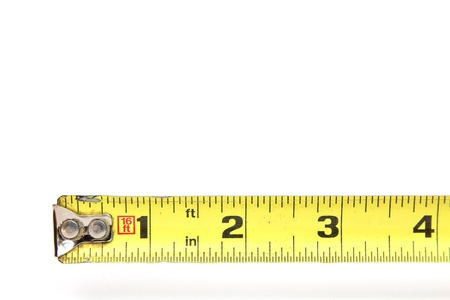 inches: Tape measure to four inches Stock Photo