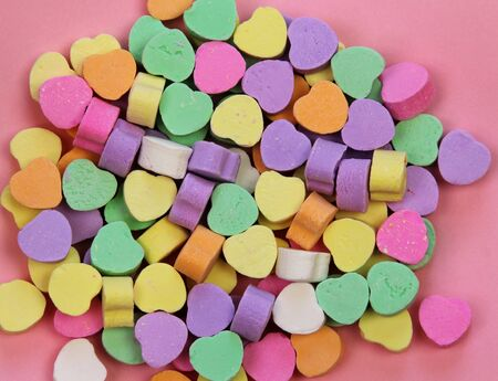 Candy hearts on pink Stock Photo