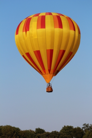 Yellow hot air balloon taking off