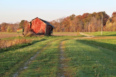 old red barn: Old red barn along a road