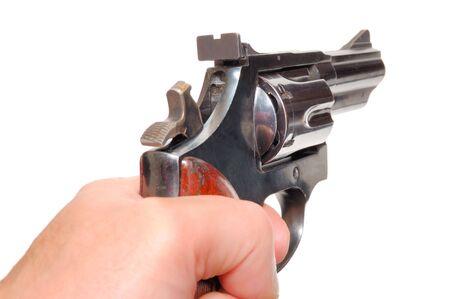 pistola: Mano con pistola aislado sobre un fondo blanco  Foto de archivo