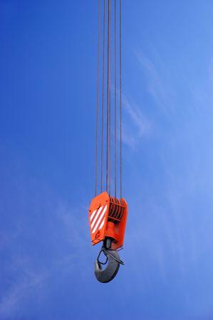 crane parts: Crane hook over blue sky