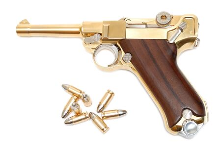 Golden gun isolated over a white background photo