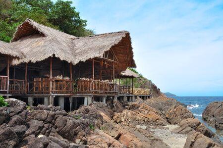 stilts: Hut built on stilts near the sea Stock Photo