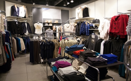 retail place: Shelves with clothes in the store