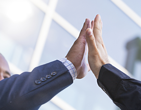 Close-up of two businessmen giving fist bump. Partnership concept Foto de archivo