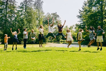 Happy children jumping with their parents