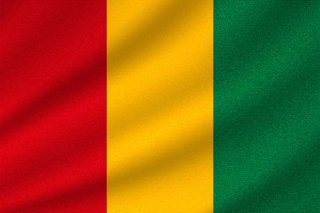 national flag of Guinea on wavy cotton fabric. Realistic vector illustration.