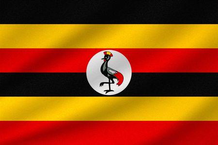 national flag of Uganda on wavy cotton fabric. Realistic vector illustration.