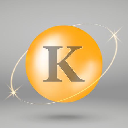 Vitamin K gold icon. drop pill capsule. Vitamin complex design