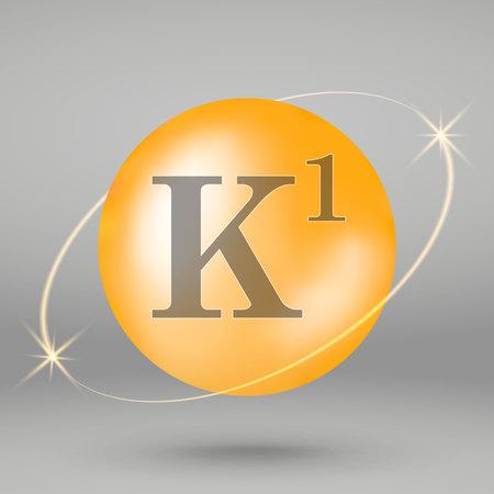 Vitamin K1 gold icon. drop pill capsule. Vitamin complex design