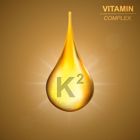 Vitamin k2 gold shining drop icon .Menaquinones Vitamin complex background Ilustração