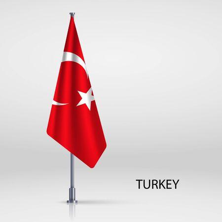 Turkey hanging flag on flagpole