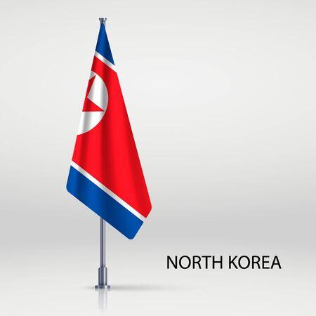 North Korea hanging flag on flagpole
