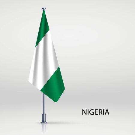 Nigeria hanging flag on flagpole