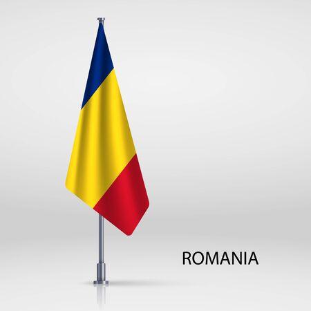 Romania hanging flag on flagpole