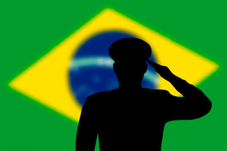 Solder silhouette on blur background with Brazil flag. Template for memorial day