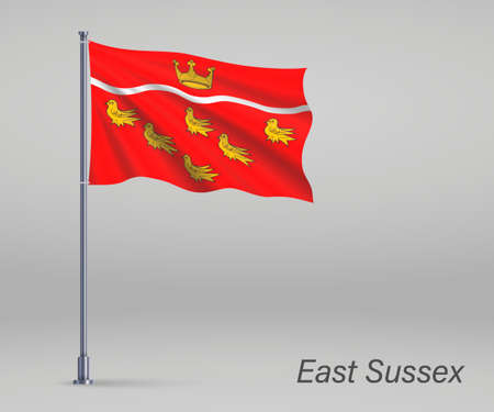 Waving flag of East Sussex - county of England on flagpole. Template for independence day