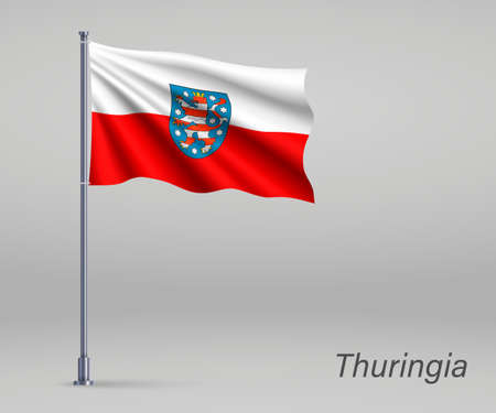 Waving flag of Thuringia - state of Germany on flagpole. Template for independence day