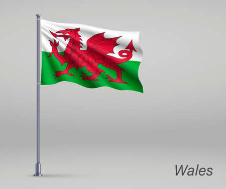 Waving flag of Wales - territory of United Kingdom on flagpole. Template for independence day