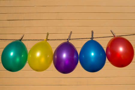 colorfull: Colorfull balloons pinned on a washing line Stock Photo