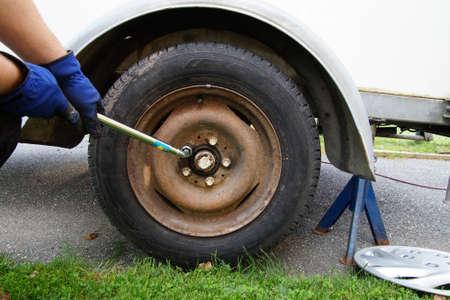 unscrewing: Brake Repair unscrewing wheel.