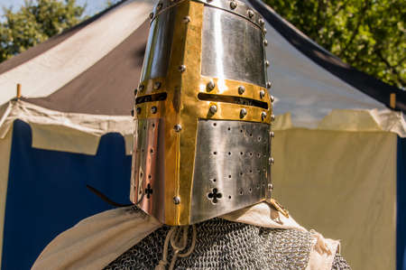 crusade: A cloese up headshot of a person dressed up historically to mimic a knights templar in full armour Stock Photo